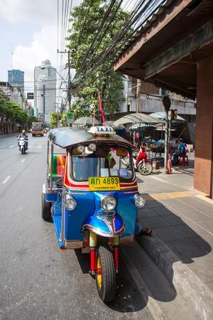 mototaxi: BANGKOK - APRIL 21, 2014: Tuk-tuk moto taxi on the street on April 21, 2014 in Bangkok. Famous Bangkok moto-taxi called tuk-tuk is a landmark of the city and popular transport. Editorial