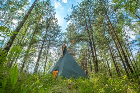 teepee: Traditional Indian tipi (teepee) house in the forest Stock Photo