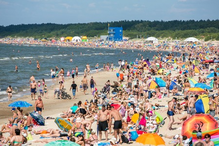 baltic people: PALANGA, LITHUANIA - JULY, 27 : People on the sunny beach of Baltic Sea on July 27, 2014 in Palanga. Palanga is very popular tourist destination for summer holidays at Baltic Sea in Lithuania. Editorial