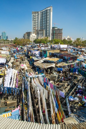 dhobi ghat: MUMBAI - 12 DECEMBER 2012: People at Dhobi Ghat, the worlds largest outdoor laundry on December 12, 2012 in Mumbai, India.