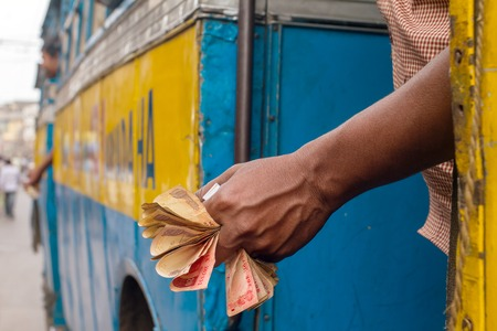 five rupee: Man holding Indian rupee notes