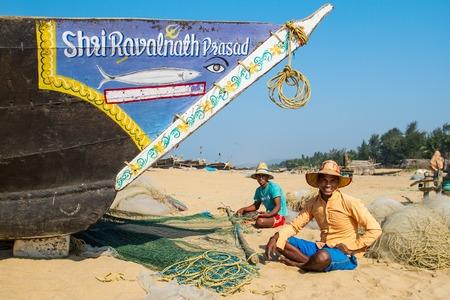 GOKARNA, INDIA - JANUARY 8: Fishermans picking up their nets on January 8, 2013, Gokarna, India.