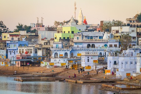 PUSHKAR, INDIA - DECEMBER 1, 2012: Holy ghats at sacred Sarovar lake in Pushkar - famous worship place in Rajasthan, India