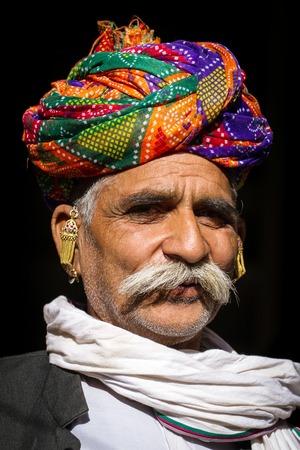 rajasthani: PUSHKAR, INDIA - 2012 DECEMBER 1: A Rajasthani man wearing traditional colorful turban posing after Pushkar Camel Fair on December 1, 2012 in Pushkar, Rajasthan, India.
