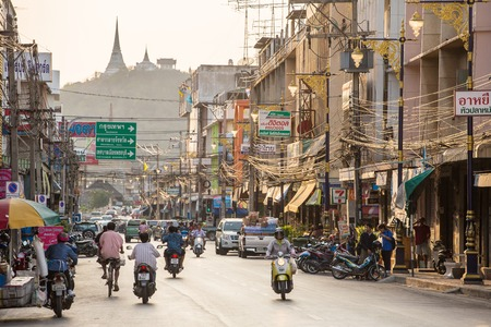 mentioned: PHETCHABURI, THAILAND - FEBRUARY 7, 2014: Unidentified people walking and driving along the street in the downtown of Phetchaburi, Thailand. on Fabriary, 7, 2014. The capital of Phetchaburi Province is one of the oldest settlements in Thailand, mentioned  Editorial