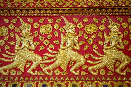 Gold on red Thai traditional temple ornament photo