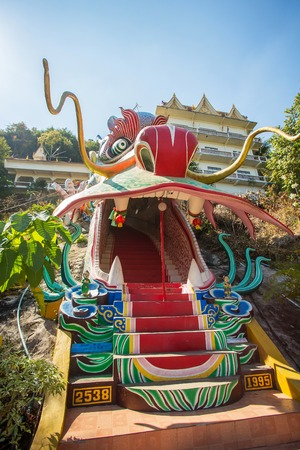 naga china: Dragon head as the entrance to Wat Ban Tham, temple in Kanchanaburi province, Thailand