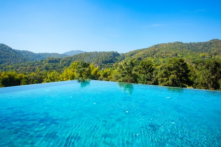 Beautiful blue pool overlooking mountain landscape Stock Photo