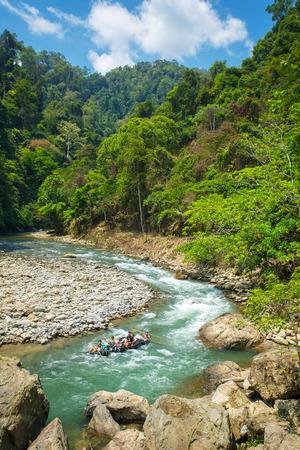 bukit: Bukit Lawang, Indonesia - March 5, 2015: Tubing in the river near Bukit Lawang village, Sumatra, Indonesia