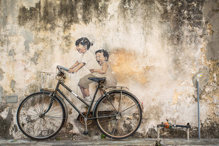 ernest: Georgetown, Penang, Malaysia - March 1, 2015: Famous graffiti of little children on a bicycle in Georgetown, Penang by Lithuanian artist Ernest Zacharevic