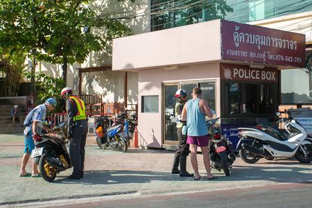 Phuket, Thailand - February 3, 2015: Road police check tourists on motorbike in Patong, Phuket, Thailand