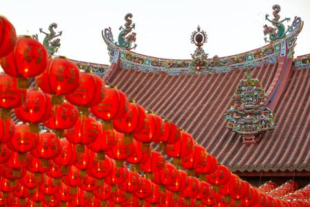 Chinese New Year red and yellow paper lanterns in Kuan Yin Temple, Penang, Malaysia photo