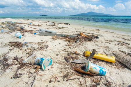 Karimunjawa, Indonesia - April 27, 2015: Garbage on the beach of uninhabited island of Karimunjawa archipelago on April 27, 2015