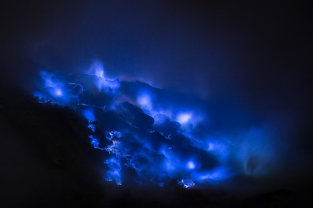 Blue sulfur flames, Kawah Ijen volcano, East Java Stock Photo