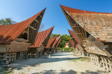 indonesia culture: Batak houses on the Samosir island, lake Toba, Indonesia, North Sumatra, Stock Photo