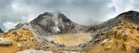 sumatra: Volcano panorama with a dramatic sky. Sibayak volcano near Berastagi in northern Sumatra, Indonesia Stock Photo