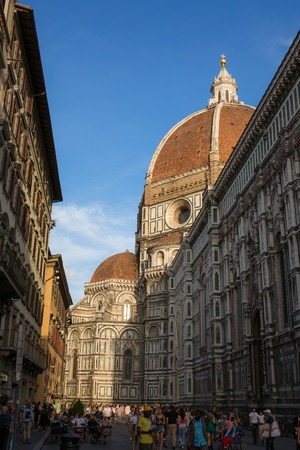 engineered: FLORENCE - SEPTEMBER 15: View the Duomo, Famous Santa Maria del Fiore cathedrall  from a street on September 15, 2015 in Florence. It was begun in 1296 and completed in 1436 with the dome engineered by Filippo Brunelleschi. Firenze, Italy Editorial