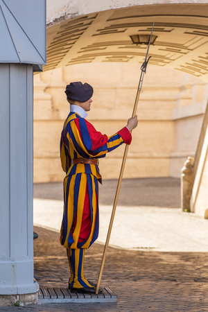 halberd: VATICAN CITY, ROME - SEPTEMBER 10:Unidentified Papal Swiss guard standing with a halberd circa September 10, 2015 in Vatican City. Vatican City State is a sovereign city-state within the city of Rome