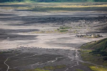 tengger: Aerial view of sea of sand inside Bromo Tengger Caldera. Pura Luhur Poten temple and jeep parking.