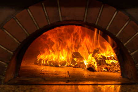 stone fireplace: Fire wood burning in the oven Stock Photo