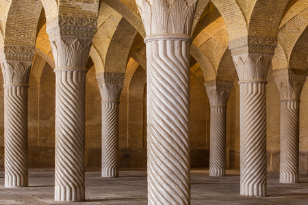 shiraz: Shiraz, Iran - December 26, 2015: Beautiful columns in Vakil Mosque, Shiraz, Iran Editorial