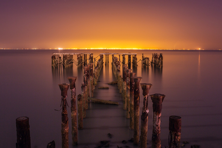 vibrance: Old abandoned jetty pier with vibrance colour. Long exposure night shot
