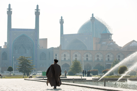 shah: Esfahan, Iran - December 13, 2015: Unidentified Mullah walk towards the Shah Mosque in Isfahan, Iran. Editorial