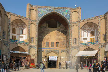 isfahan: Isfahan, Iran - December 13, 2015: Qeysarieh Portal, main entrance to market (Bazaar) in Isfahan, Iran.