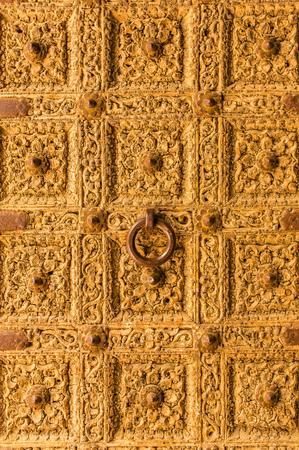 haveli: Golden door close up. Detail of Patwa Haveli in Jaisalmer, Rajasthan, India Stock Photo