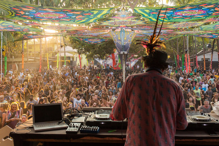 hallucinogen: Goa, India - February 7, 2016: Simon Posford playing on the stage of HillTribe club in Goa, India. Simon Posford, better known by his stage name Hallucinogen is an English electronic musician, specializing in psychedelic trance music. Editorial