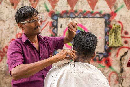 Mumbai, India - February 28, 2016: Roadside barber shop downtown in Mumbai, Maharashtra State, India. Stock Photo - 58570751