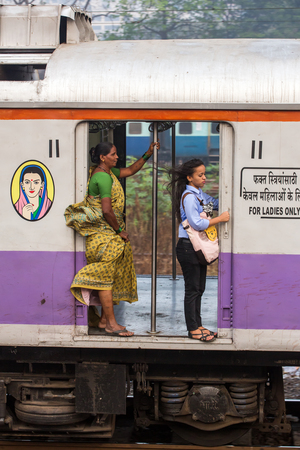 Mumbai, India - February 29, 2016: Unidentified women traveling via Suburban train in ladies only carriage in Mumbai, India.