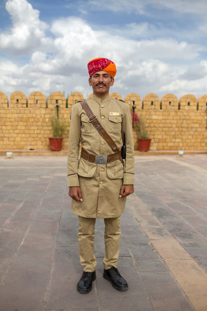 rajasthani: Jaisalmer, India - March 13, 2016: Hotel guard with moustache and traditional rajasthani turban posing for photo.