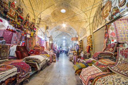 shiraz: Shiraz, Iran - December 24, 2015: Traditional iranian carpets shop in Vakil Bazaar, Shiraz, Iran. Vakil Bazaar is the most important tourist attraction in Shiraz, Iran. Editorial