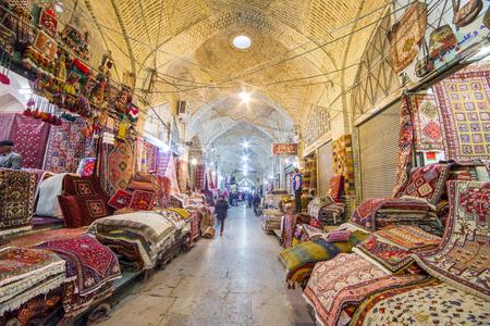 Shiraz, Iran - December 24, 2015: Traditional iranian carpets shop in Vakil Bazaar, Shiraz, Iran. Vakil Bazaar is the most important tourist attraction in Shiraz, Iran.