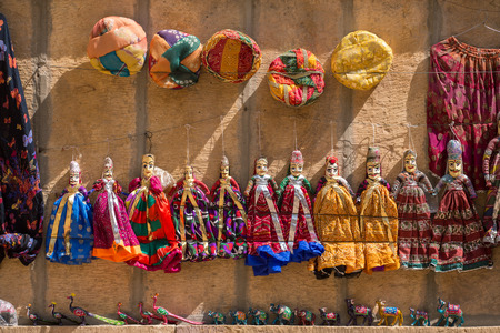 queen's theatre: Souvenir Rajasthan puppets hanging in the street shop of Jodhpur, India Editorial