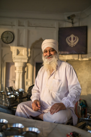 bushy: Amritsar, India - March 30, 2016: Portrait of Indian sikh man in turban with bushy beard in Golden temple in Amritsar