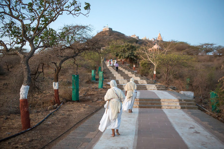 gujarat: Palitana, India - March 6, 2016: Jain nuns on parikrama, walking pilgrimage, to Jain temples on top of Shatrunjaya hill, Palitana (Bhavnagar district), Gujarat, India Editorial