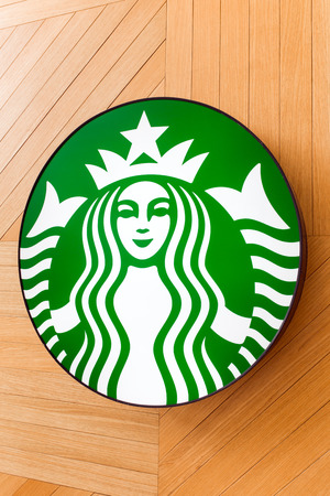 kota kinabalu: Kota Kinabalu, Malaysia - May 31, 2016: The Starbucks Coffee sign at the wooden background in shopping mall, in Kota Kinabalu, Malaysia. Starbucks is the worlds largest coffee house with over 20,000 stores in 61 countries.