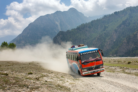 Dana, Nepal - May 15, 2016: Local nepalese bus driving crazy in the countryside of Himalayan region of Nepal. Stock Photo - 60285751