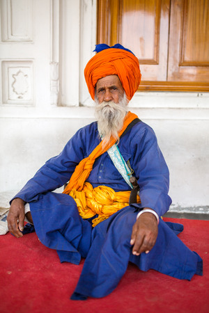 bushy: Amritsar, India - March 29, 2016: Portrait of Indian sikh man in turban with bushy beard in Golden temple in Amritsar, India.