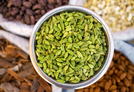 cardamon: Various of Indian spices on the market in India. Cardamon seeds close-up. Stock Photo