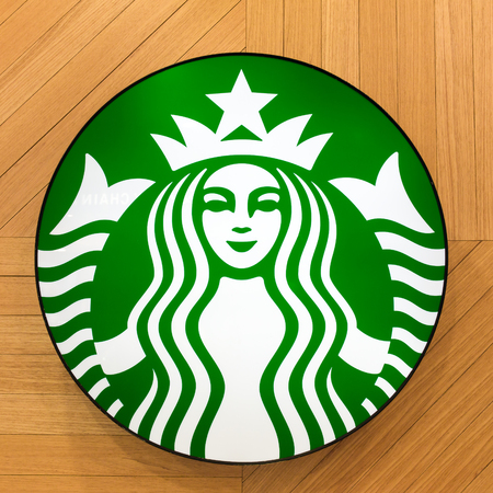 kota kinabalu: Kota Kinabalu, Malaysia - May 31, 2016: The Starbucks Coffee sign at the wooden background in shopping mall, in Kota Kinabalu, Malaysia. Editorial