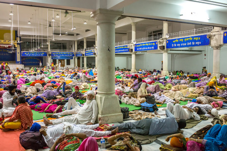 dome of hindu temple: Amritsar, India - March 29, 2016: Unidentified indian people sleeping on the floor in the pilgrims dormitories of the Sikh Golden Temple in Amritsar, India
