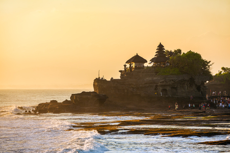Tanah Lot temple and sea waves in beautiful sunset light, Bali, Indonesia Stock Photo