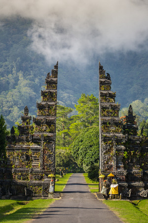 Traditional Balinese Hindu gate at rainy day, Bali, Indonesia