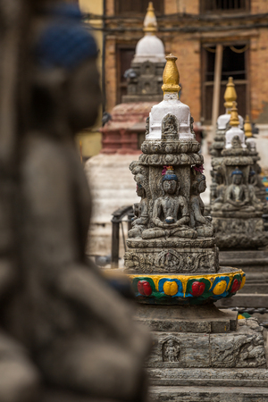 Buddha statue on the square near Swayambhunath stupa in Kathmandu valley, Nepal Stock Photo