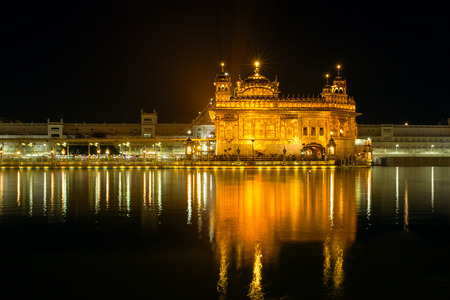 gurudwara: Golden Temple (Harmandir Sahib) at night in Amritsar, Punjab, India Stock Photo