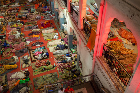 dormitories: Amritsar, India - March 29, 2016: Unidentified indian people sleeping on the floor in the pilgrims dormitories of the Sikh Golden Temple in Amritsar, India