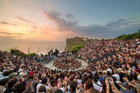 kecak: Bali, Indonesia - September 19: Tourists watch traditional Balinese Kecak Dance at Uluwatu Temple on Bali, Indonesia. Kecak (also known as Ramayana Monkey Chant) is very popular cultural show on Bali. Editorial